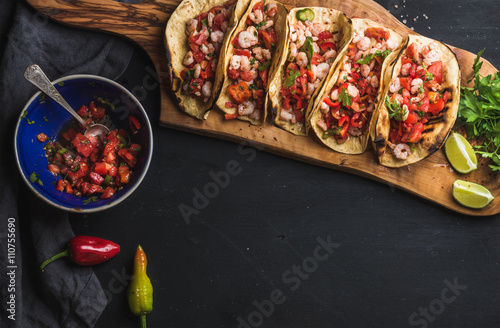Vászonkép  Shrimp tacos with homemade salsa, limes and parsley