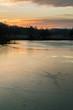 Sunset over frozen pond