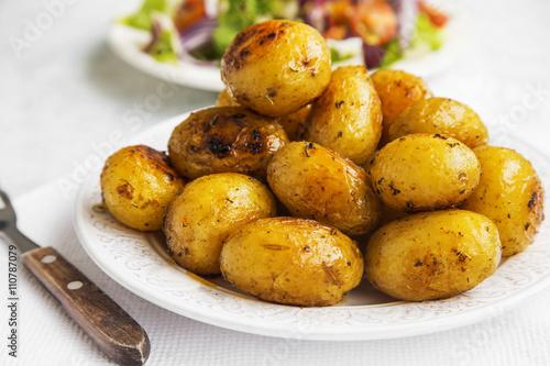 fototapeta na lodówkę Young baked potatoes