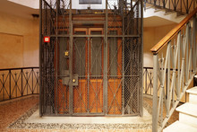 Old Wooden Elevator In A Metal...