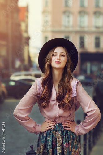 Outdoor Portrait Of Young Beautiful Fashionable Playful Lady