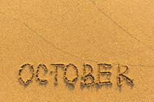 October - Word Inscription On The Gold Sand Sea Beach.