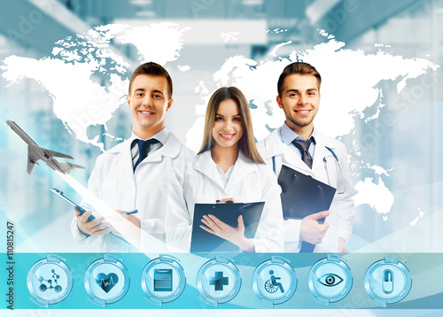 Three doctors and virtual screen. Medical tourism concept