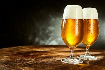 Fototapeta Two glasses full of beer on table