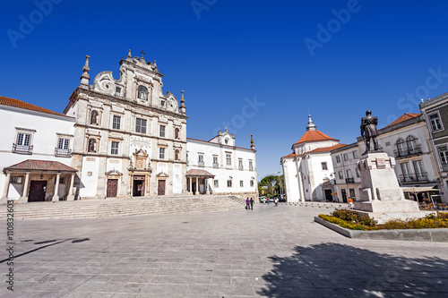 Fotografia, Obraz  Sa da Bandeira Square with a view of the Santarem See Cathedral aka Nossa Senhora da Conceicao Church, built in the 17th century Mannerist style