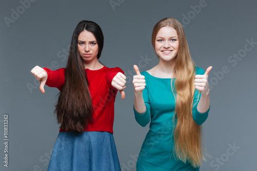 Fotografie, Obraz  Two women over gray