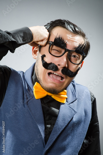 Photo  Funny man against dark background