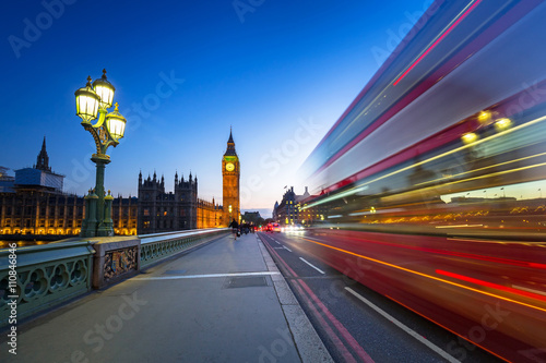 London scenery at Westminter bridge with Big Ben and blurred red bus, UK плакат