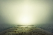 Stone Pier In Thick Fog.
