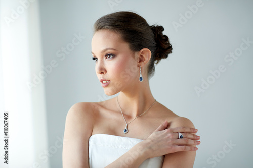 beautiful woman with earring, ring and pendant - 110867405