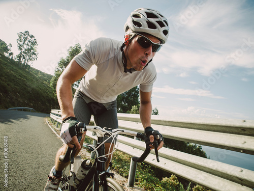 Cyclist in maximum effort pedaling outdoors Canvas Print