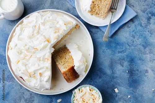 Fényképezés  Three milk cake, tres leches cake with coconut