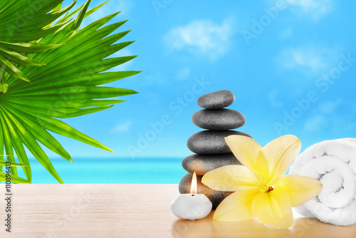 Fototapety, obrazy: Spa stones with candle, towel and lily on seascape background