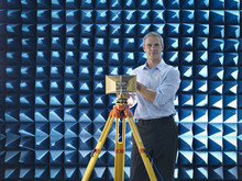 Scientist Preparing To Measure Electromagnetic Waves In Anechoic Chamber, Portrait