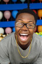 Teenage Boy Laughing At Amusement Park