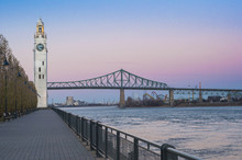 Waterfront View Of Clock Tower And Jacques Cartier Bridge At Sunset, Montreal, Quebec, Canada