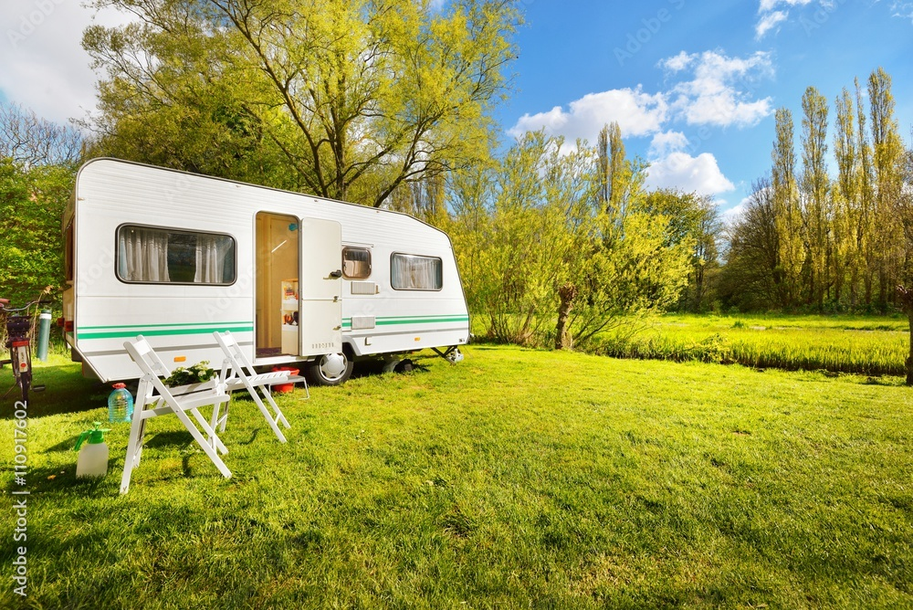 Fototapety, obrazy: Caravan trailer on a green lawn, on a sunny spring day