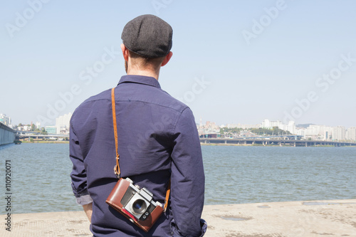 Rear view of male tourist looking at view of river, Seoul, South Korea