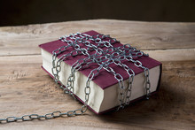 Book With Chains Wrapped Aroun...