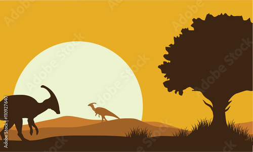 Photo Silhouette of parasaurolophus with sun
