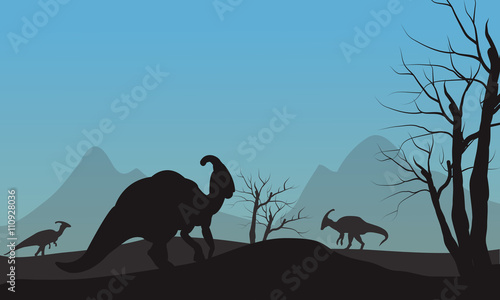 Photo Silhouette of parasaurolophus in hills