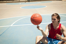Young Male Basketball Player Spinning Ball On Finger