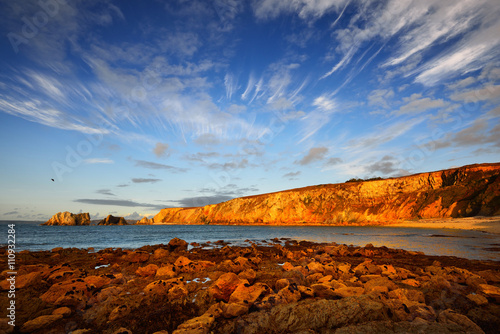 View of an ocean coastline during sunset at Pointe de Toulinguet in Brittany, Fr Fototapeta