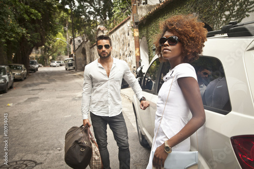 Couple arriving by limousine Poster