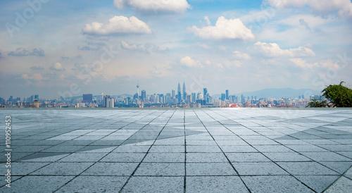 Aluminium Prints Dark grey Panoramic skyline and buildings with empty concrete square floor