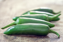 Mexican Hot Chili Jalapeno Peppers On Wooden Background