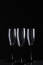 Three Clear Champagne Glasses ...