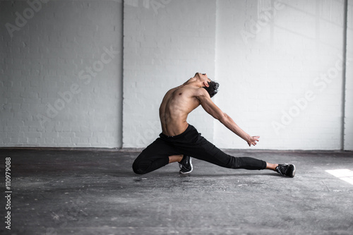 Dancer practising in studio Plakát