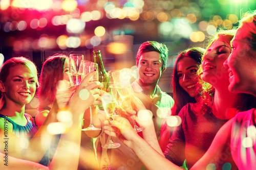 smiling friends with wine glasses and beer in club Poster