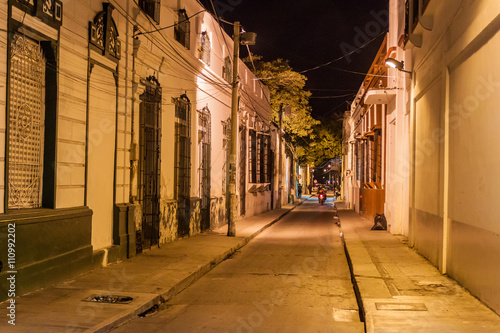 Fotografie, Obraz  View of a night street in the center of Santa Marta, Colombia