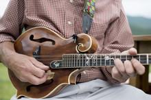 Mature Man Playing Mandolin, Mid Section, Close-up