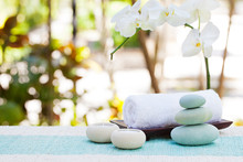 Spa And Wellness Massage Setting Still Life With Candle, Towel And Stones Outdoor Summer Background