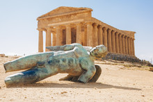 Modern Sculpture Of Icarus In Front Of The Temple Of Concordia, Valley Of The Temples, Sicily, Italy