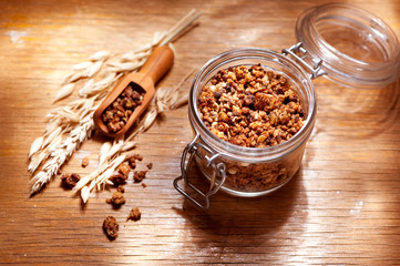 Fototapeta Granola in a glass jar
