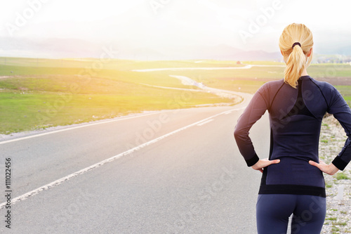 Staande foto Meloen Woman athlete runner getting ready to run in beautiful nature mountain landscape. Jogging, sport, fitness, active lifestyle concept