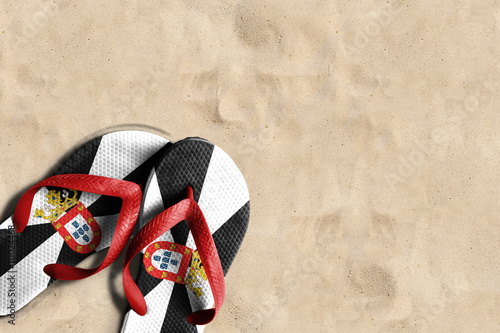 Thongs with flag of Ceuta, on beach sand