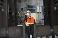Dock Worker Giving Instruction At Port