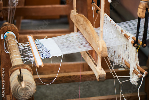 Fotografie, Obraz  The production process of the handmade textiles on the loom