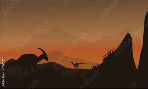 Photo On the hills silhouette eoraptor and parasaurolophus