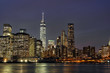 Downtown Manhattan at night with the new World Trade Center and East River