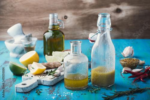 Fototapeta Vinaigrette and ingredients, salad dressing with oil, vinegar