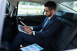 Business executive getting ready to presentation when sitting in car