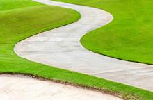 Path Curving Through Green Gra...