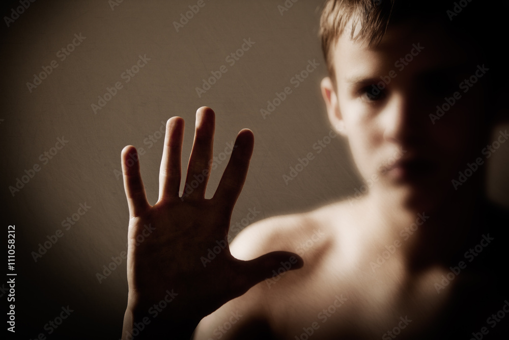 Photo  Young Serious Teenage Boy Holding Up Hand