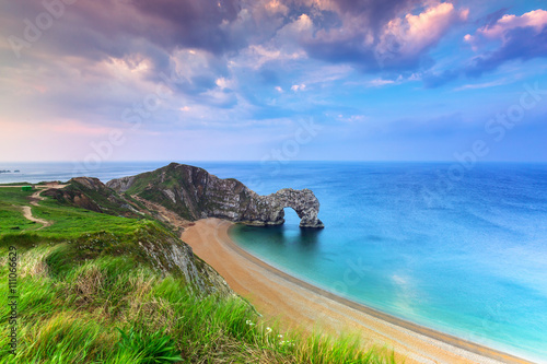 Montage in der Fensternische Kuste Jurassic Coast of Dorset with Durdle Door at sunrise , UK