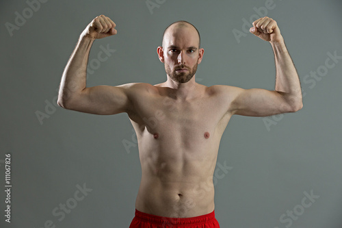 Fotografie, Obraz  Fitness man with his strong arms